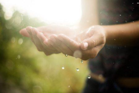 hand-woman-rain